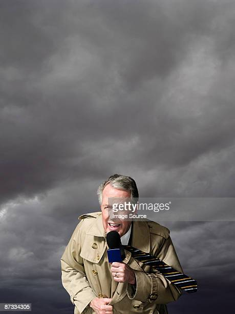 News presenter in storm