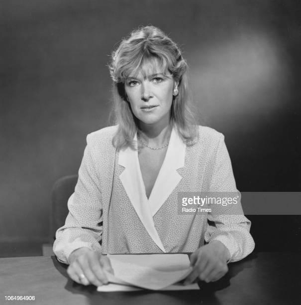 News reader Julia Somerville pictured behind a desk in a television studio, circa 1985.