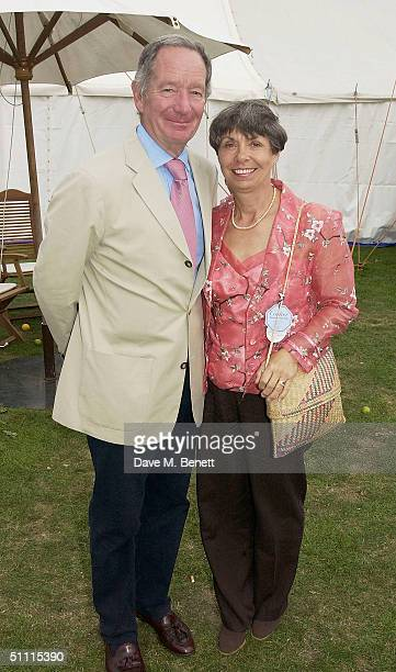 TV News Reader Michael Buerk and his wife attend the biggest European polo tournament at Cartier International Day held at Guards Polo Club Windsor...