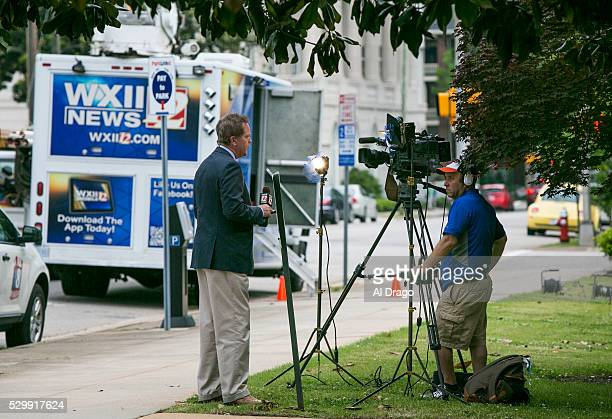 STATES MAY 9 A news reporter does a live shot for the evening news outside of the Governor's Mansion in Raleigh NC on Monday May 9 2016 Gov Pat...