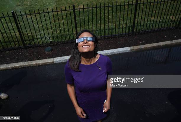 News reporter Kristen Welker wears special glasses to view the solar eclipse, at the White House on August 21, 2017 in Washington, DC. Millions of...