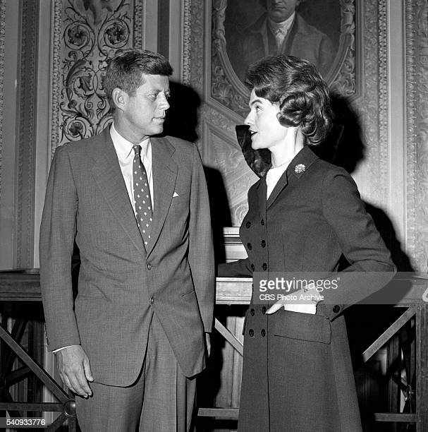 News reporter Nancy Hanschman in Washington, DC with John F. Kennedy. Image dated February 4, 1960.