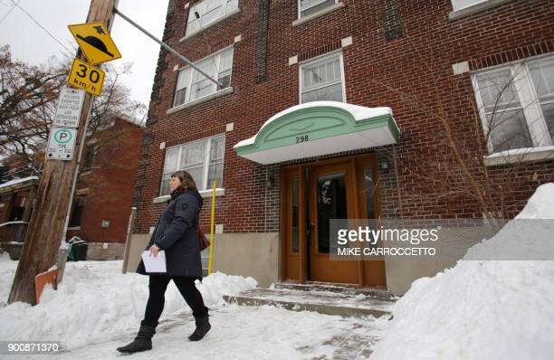 A news reporter walks away from an apartment building in Ottawa Canada January 3 2018 where former Taliban hostage Joshua Boyle had been living with...