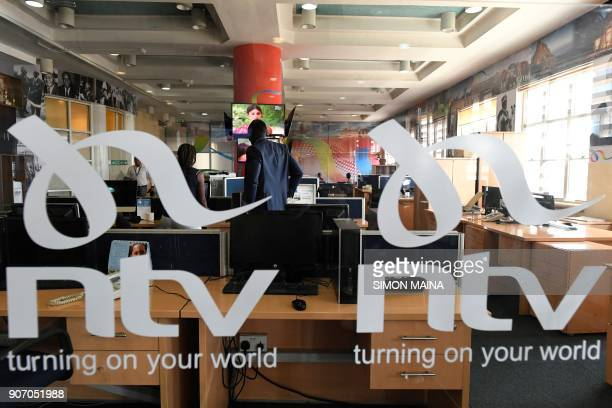 NTV news reporters are pictured in their desk in a newsroom of Kenyan 'Nation Media Group' in Nairobi on January 19 2018 / AFP PHOTO / SIMON MAINA