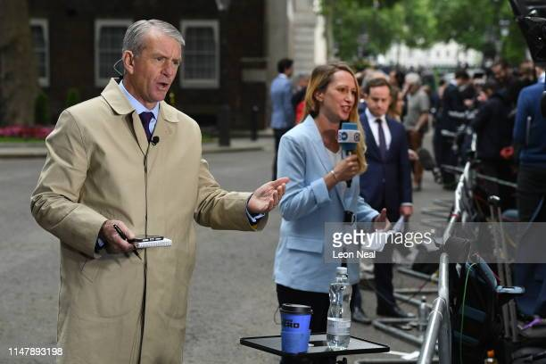 TV news reporters broadcast prior to the arrival of US President Donald Trump at Downing Street during the second day of his State Visit on June 4...