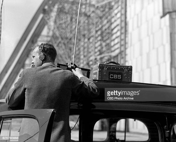News reports on the Hindenburg disaster in Lakehurst NJ on May 7 the day after the tragedy occurred In this frame a Radio Technician works on location