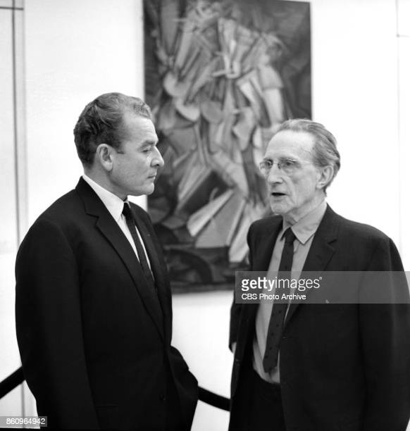 News series Eyewitness to History. . CBS News reporter Charles Collingwood with artist Marcel Duchamp and his painting Nude Descending a Staircase....