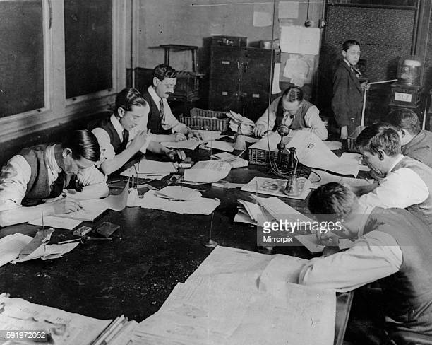 News staff as work in the sub editors room at the Daily Mirror offices in Gerladine House Fetters Lane 1927
