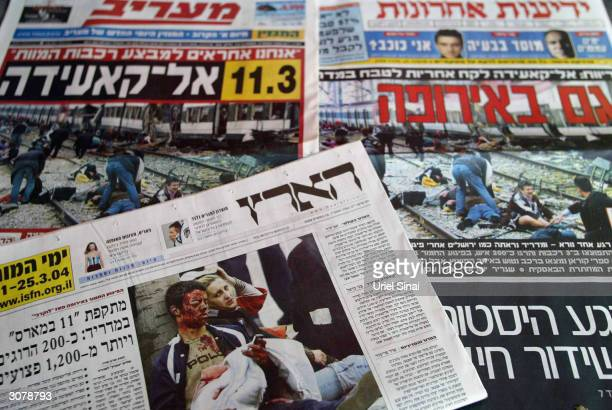 A news stand displays newspapers with images of yesterdays terror attacks in Madrid on the front pages March 12 2004 in Tel Aviv Israel The Israeli...