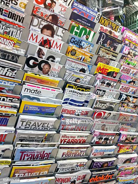 news stand with magazines in new yrok city - manhattan magazine stock photos and pictures