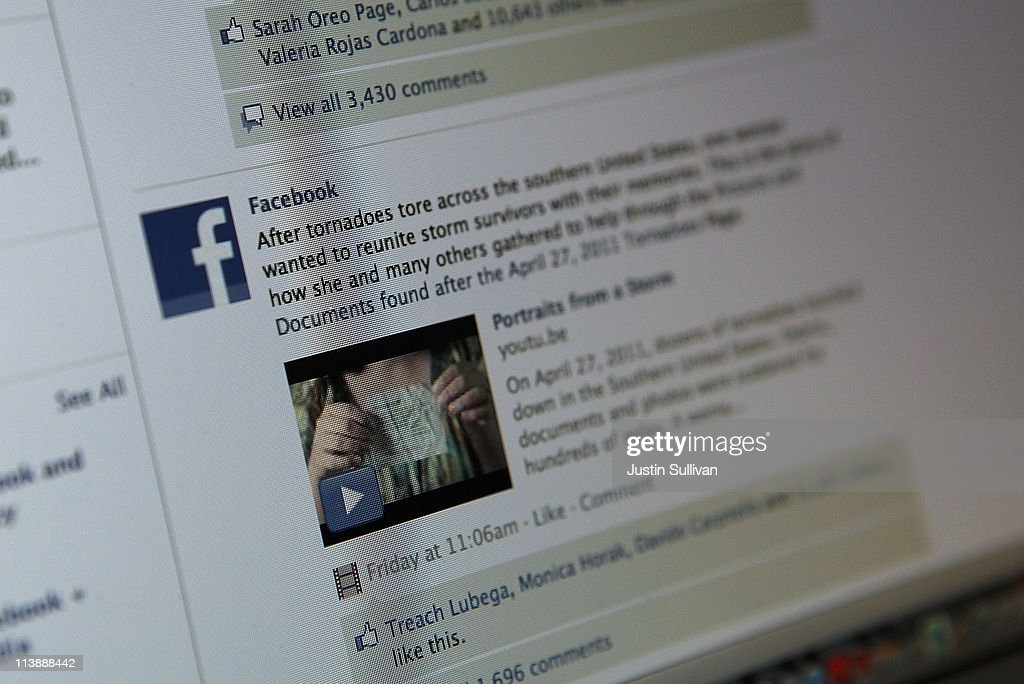 A news story about recent tornadoes is seen on the Facebook website that is displayed on a laptop computer on May 9, 2011 in San Anselmo, California. An investigation by The Pew Research Center found that Facebook has become a player in the news industry as the popular social media site is driving an increasing amount of traffic to news web sites.