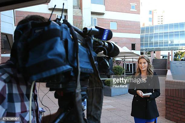 A news television crew do a live broadcast outside the Hyatt Regency Perth where Mick Jagger and the Rolling Stones are staying during the first leg...