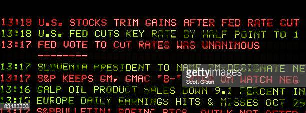 News ticker flashes news of a rate cut above the S&P 500 stock index futures pit following the announcement by the Federal Reserse that it would cut...