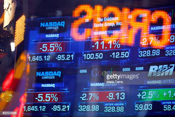 News tickers at the Nasdaq MarketSite show negative numbers October 9 2008 in New York City The Dow Jones industrials lost 678 points to close below...