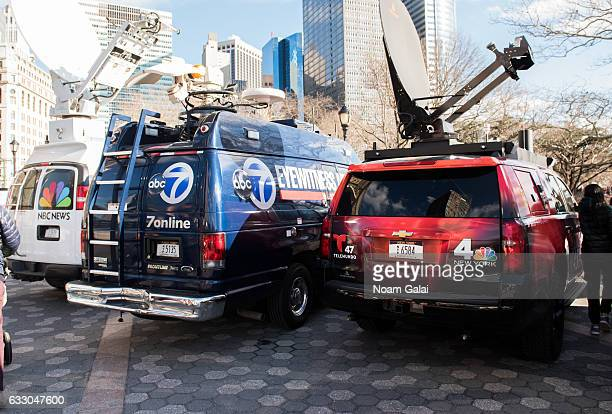 News trucks are seen during a rally to protest the executive order that President Donald Trump signed clamping down on refugee admissions and...