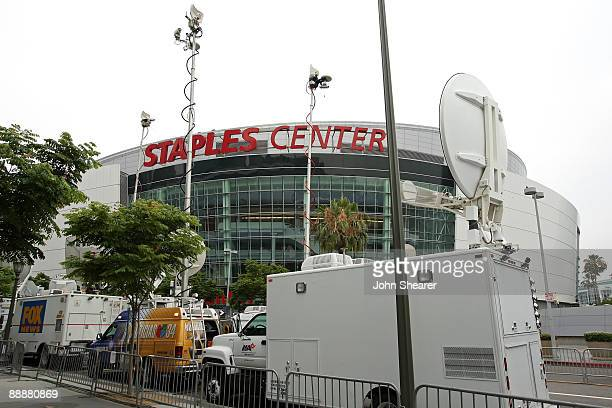 News vans park outside the Michael Jackson public memorial service held at Staples Center on July 7, 2009 in Los Angeles, California. Jackson the...