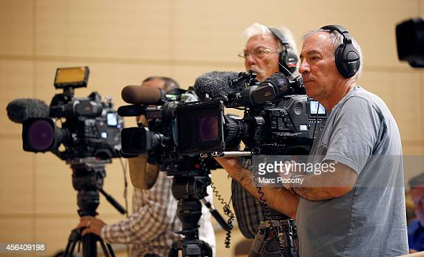 News videographers film as Children's Hospital Colorado experts speak during a press conference at the hospital September 30 to update the media on...