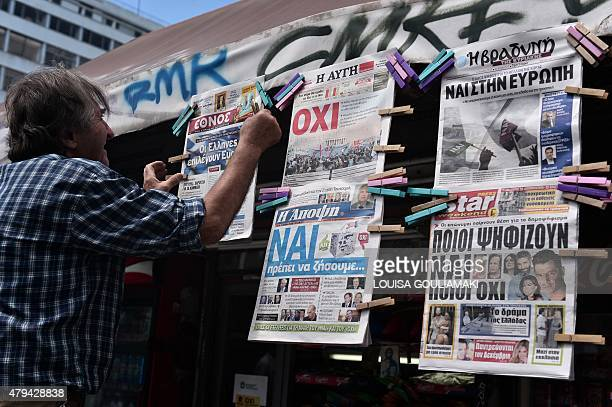 A newsagent hangs newpapers bearing No and Yes headlines in central Athens on July 4 on the eve of the Greek referendum on its bailout terms Nearly...