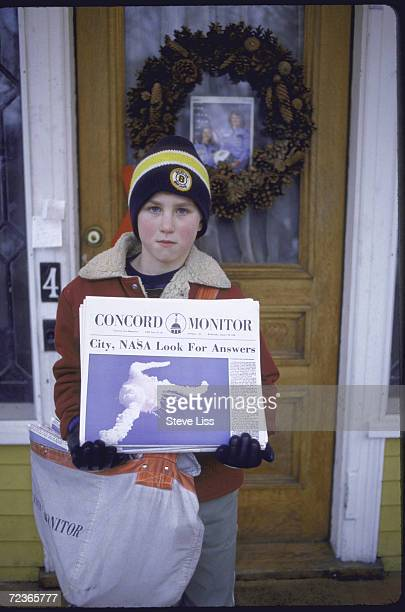 Newsboy holding edition of the Concord Monitor headlining Challenger disaster death of local teacher/astronaut Sharon Christa McAuliffe