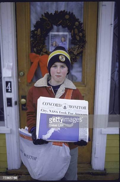 Newsboy holding edition of the Concord Monitor headlining Challenger disaster death of local teacher/astronaut Sharon Christa McAuliffe