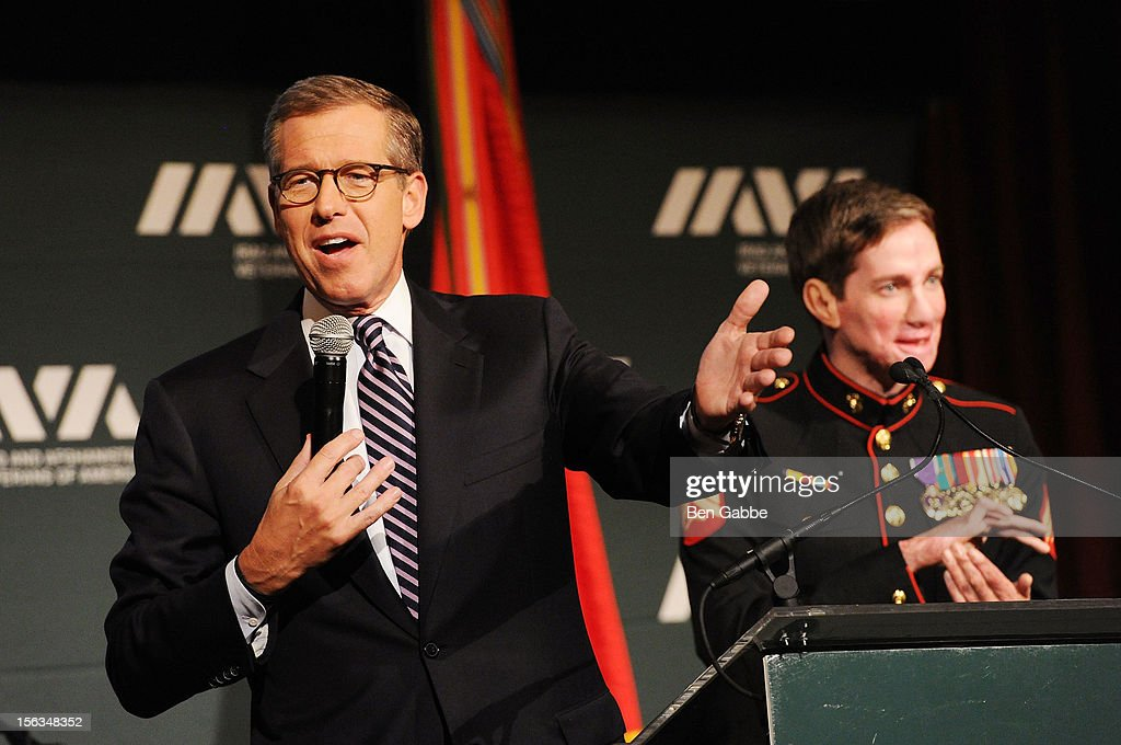 Newscaster Brian Williams (L) and Veteran Aaron Mankin speak at IAVA's Sixth Annual Heroes Gala at Cipriani 42nd Street on November 13, 2012 in New York City.