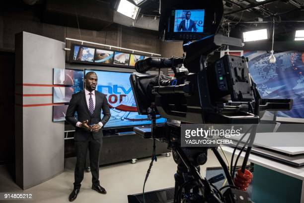 A newscaster looks on during a news program at NTV in Nairobi Kenya on February 6 2018 The Government disconnected three major Kenyan television...