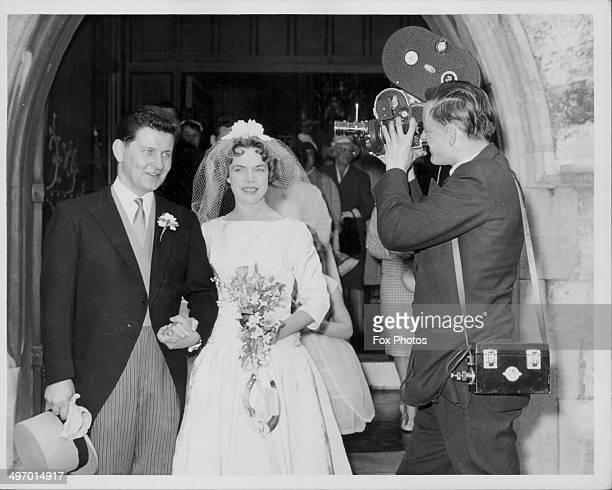 BBC newscaster Richard Baker getting married to Margaret Celia Martin at St Mary's Church as BBC cameraman Gerald Rowley films the occasion London...