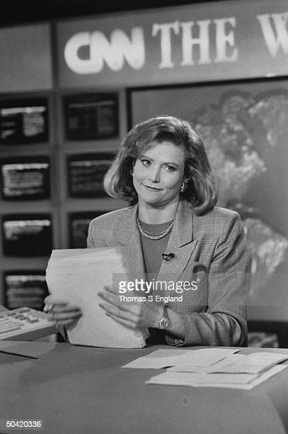 CNN newscaster/exjudge Catherine Crier at desk w papers on set at TV studio after a broadcast