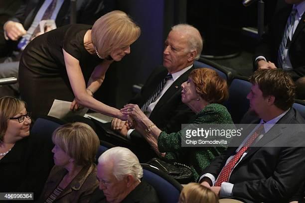 NewsHour CoAnchor Judy Woodruff shakes hands with Sarah Brady widow of former White House Press Secretary James Brady during his memorial service as...