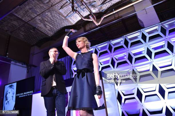 Newsmaker of the Year Chelsea Manning celebrates on stage with OUT Magazine Executive VP Publishing Joe Landry pose for a photo on stage during OUT...