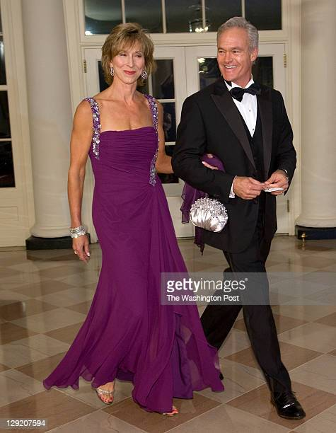 Newsman Scott Pelley and wife Jane Boone Pelly arrive for tonight's Korean State Dinner at the White House on October 2011 in Washington, DC.