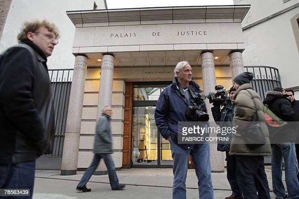 Newsmen are seen in front of Geneva's Law Courts 19 December 2007 during a public hearing of Cecile Brossard who confessed on 2005 the sexrelated...