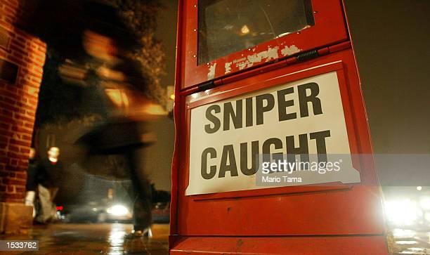 "Newspaper box headline reading ""Sniper Caught"" is seen on a Georgetown street a day after suspects John Allen Muhammad and John Lee Malvo were..."