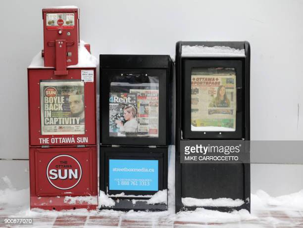 A newspaper box shows former Taliban hostage Joshua Boyle on the front page of a local paper in Ottawa Canada January 3 2018 Boyle who was held...