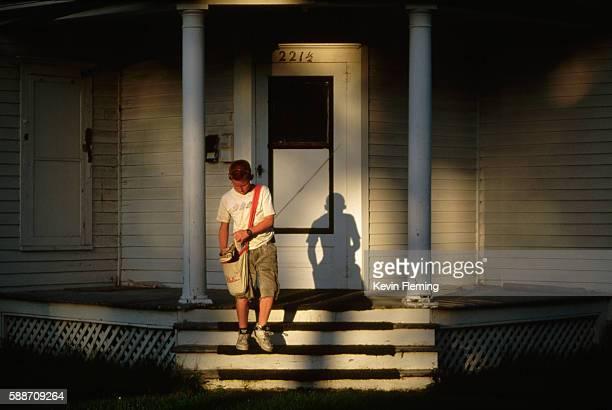 Newspaper Boy Delivering Morning Paper