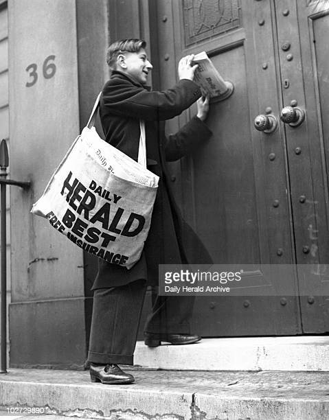 Newspaper boy delivering the 'Daily Herald' 13 December 1935 ' Paper boy delivering the 'Daily Herald' newspaper Photograph by Harold Tomlin