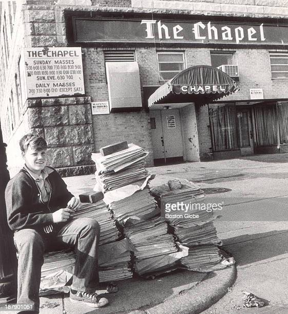 Newspaper boy Steve Nee waits to sell his papers in front of The Chapel