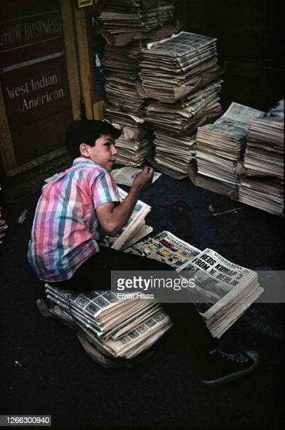 A newspaper boy with copies of the New York Sunday News New York City 1952 The headline 'Reds Kidnap 3 From W Berlin' refers to a Cold War incident