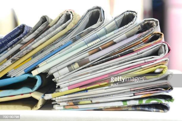 newspaper bundle - publication stock pictures, royalty-free photos & images