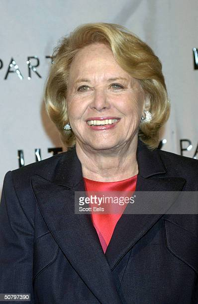 Newspaper columnist Liz Smith poses backstage for the 20th Anniversary Celebration of Literacy Partners where famous authors and politicians read...