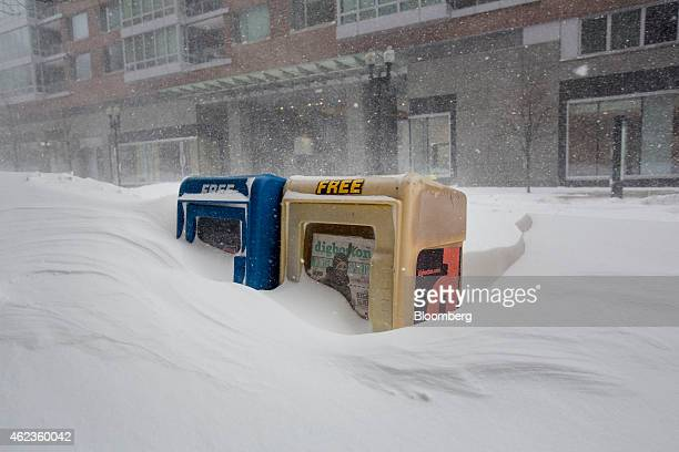 Newspaper dispensers stand covered in snow on Charles Street as winter storm Juno continues to move through Boston Massachusetts US on Tuesday Jan 27...