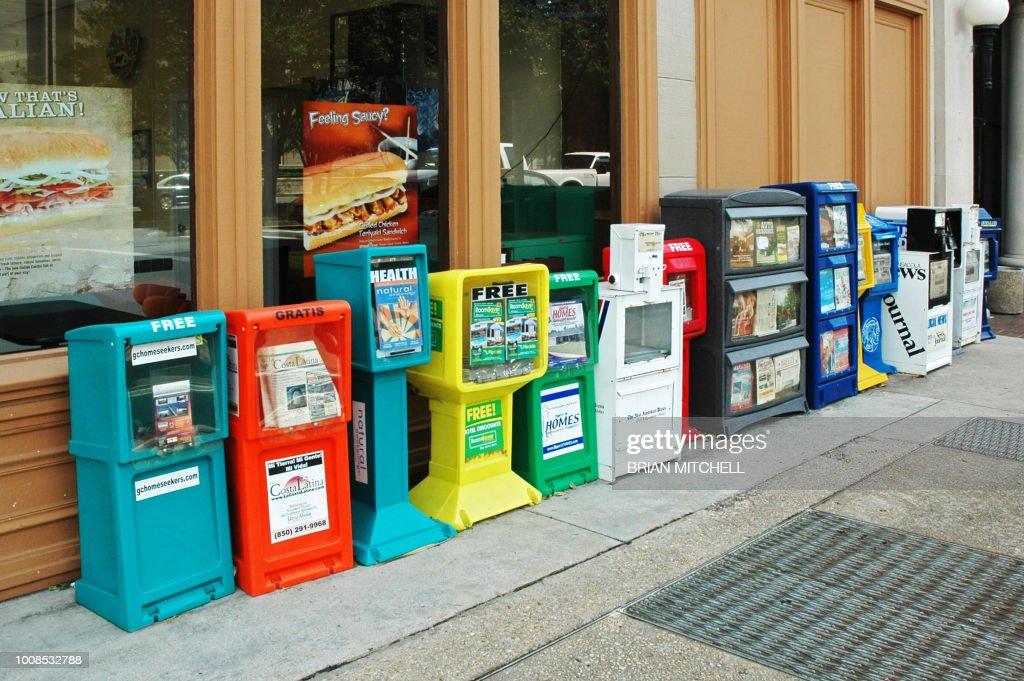 Newspaper dispensing machines, Palofox Street, Pensacola, Florida, USA. : Stock Photo