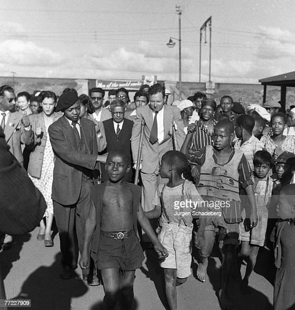 Newspaper editor and son of Mahatma Gandhi Manilal Gandhi and Patrick Duncan lead a procession into Germiston in the Gauteng province of South Africa...