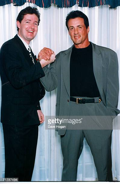 Newspaper editor Piers Morgan poses with actor Sylvestor Stallone during his time as editor of the Bizarre showbusiness column of The Sun newspapers....