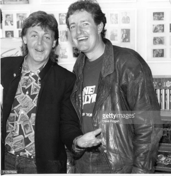 Newspaper editor Piers Morgan poses with musician Paul McCartney during his time as editor of the Bizarre showbusiness column of The Sun newspapers....