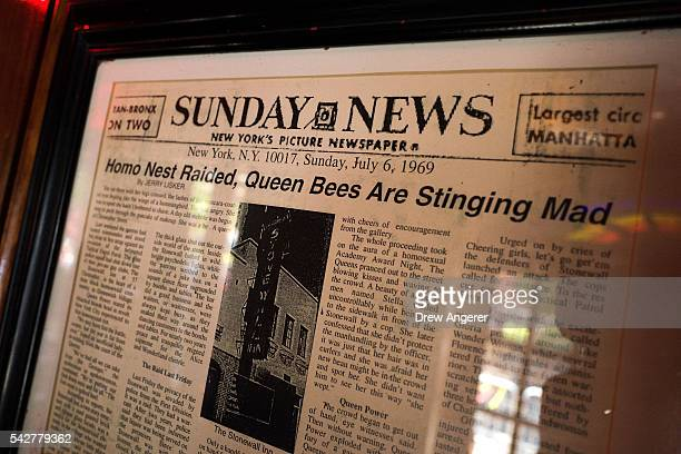 A newspaper from 1969 hangs on the wall near the front entrance at the Stonewall Inn on June 24 2016 in New York City President Barack Obama...