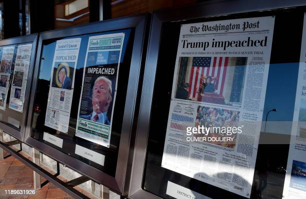 Newspaper front pages are on display at the Newseum in Washington, DC, on December 19 after US President Donald Trump's historic impeachment by the...