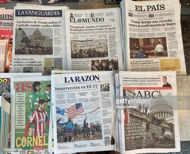 Newspaper front pages show yesterday's storming of the U.S. Capitol by supporters of U.S. President Donald Trump on January 07, 2021 in Madrid,...
