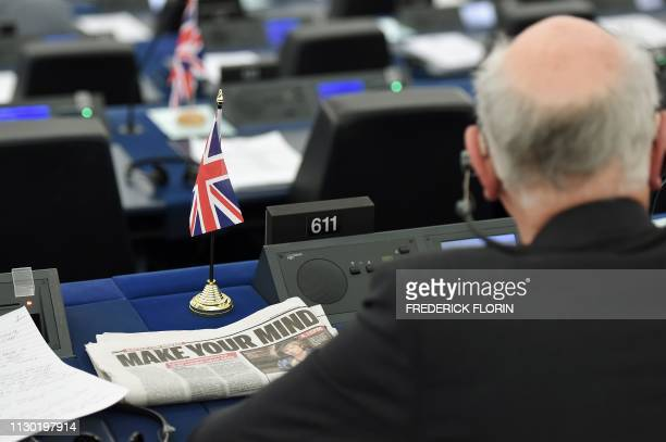 A newspaper headline focused on the Brexit and reading Make your mind is seen next to a MEP attending a debate on the preparation of the upcoming...