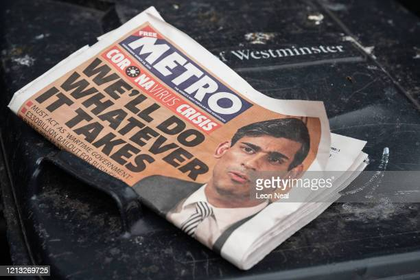 """Newspaper headline reading """"We'll Do Whatever It Takes"""" is seen on March 18, 2020 in London, England. Wales and Scotland have today announced that..."""